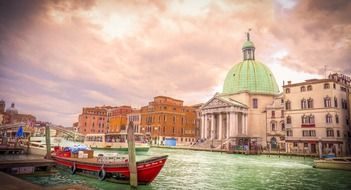 colorful boats on channel in view of landmarks, italy, venice