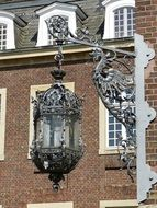 Wrought iron lantern on a baroque building