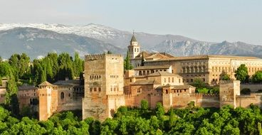 Alhambra, palace and fortress complex at snow-capped mountains,spain, granada