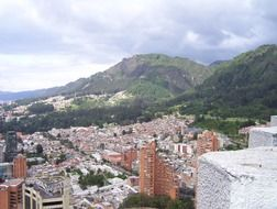 scenic sityscape with green mountains, colombia, bogota