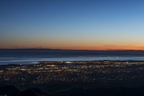 city lights on seacoast at dusk, usa, california, santa barbara