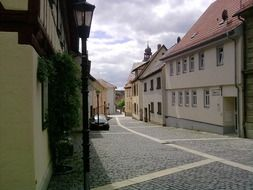 alley with cobblestone pavement in old town