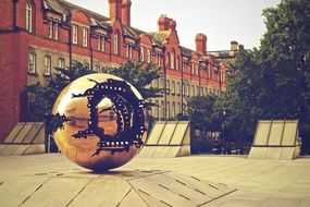 sphere within sphere, modern bronze sculpture at old mansion, uk, ireland, Dublin, Trinity College