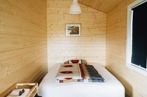 small bedroom in log cabin