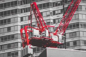 construction red crane black white buildings