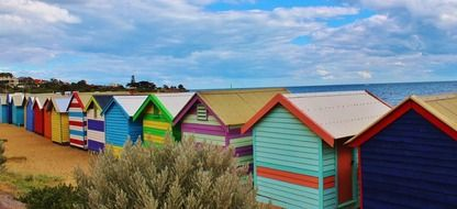 row of colorful beach houses at sea, australia
