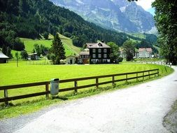 summer mountain landscape with village at road, switzerland