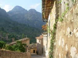 grunge facades of old houses at mountains, spain, mallorca