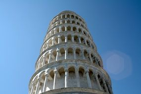low angle view of leaning tower at clear blue sky, italy, pisa