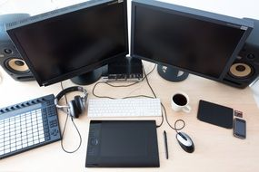 graphics station, computer and digital devices on desk