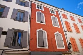 terraced houses with shutters at windows on colorful facades