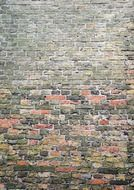 surface of old grey and red brick wall