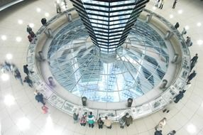 people in interior of reichstag glass Dome, germany, berlin