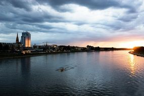 Drava river with city on coast at dusk, croatia, osijek