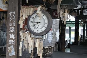 old hanging clock in train station