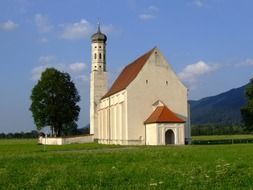St. Coloman's sanctuary on meadow near mountains, Germany, Allgaeu