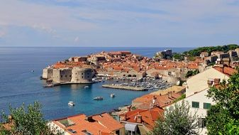 old town with red tile roofs at sea, croatia, dubrovnik