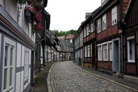 picturesque street with truss houses and cobblestone pavement, germany, goslar