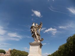 angel with column at sky, statue on Bernini Bridge, Italy, Rome