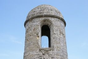 stone tower of medieval fort at sky
