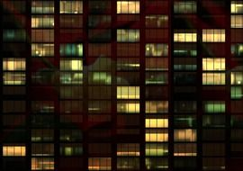 light in windows of office building at night