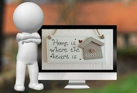 white man next to a computer monitor