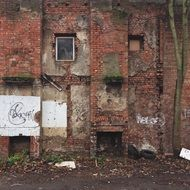 ruined brick wall of abandoned building