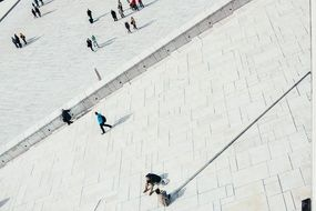 people walking pedestrians stones shadows