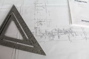 drawing building plans with a pencil and a ruler