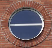 round window in red brick wall