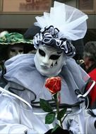 white masked person in full body costume on carnival, italy, venice