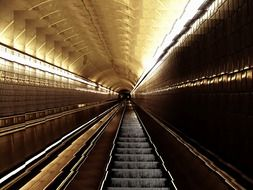 perspective of escalator stairs in underground