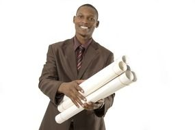 smiling dark skin man with rolled sheets of paper in hands