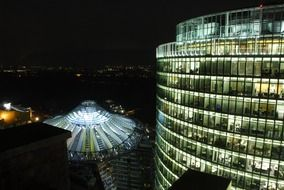 roof view of sony center in night city, germany, berlin