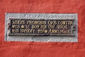 red wall building inscription