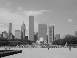 fountain in park at city skyline, usa, illinois, chicago