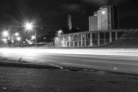 street lights at road in night city, black and white
