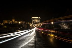 traffic lights on chain bridge at night, long shutter speed, hungary, budapest