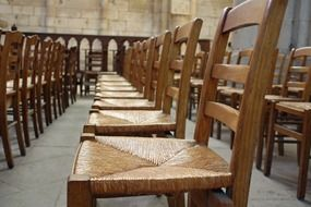 wooden chairs arranged in rows