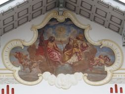 the holy trinity, painting on church facade, germany, bad tölz