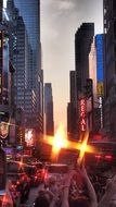 people taking photo of sunset on time square, usa, manhattan, new york city