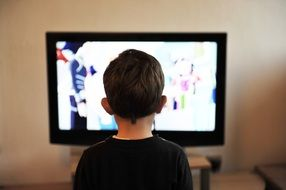 child boy watching tv at home