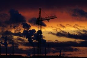 tower crane at cloudy sunset sky