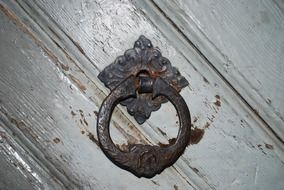 vintage metal door knocker on wooden door