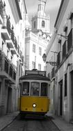 yellow tram on narrow street, portugal, lisbon