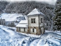 scenic winter landscape, old stone building at snowy forest, austria