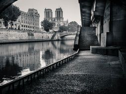 Front view of Notre Dame cathedral from sidewalk at water, france, paris