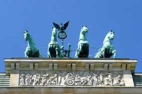 quadriga atop of brandenburg gate at sky, front view, germany, berlin