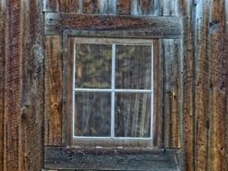 window on old brown wooden wall