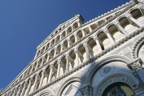diagonal low angle view of cathedral facade at sky, italy, pisa